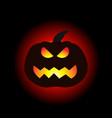 a lit halloween pumpkin on the dark background vector image
