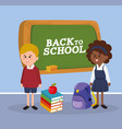 boy and girl students with blackboard and books vector image