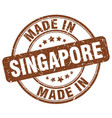 made in singapore brown grunge round stamp vector image vector image