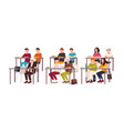 group of pupils sitting at desks in classroom vector image vector image