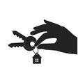 hand holding house key - eps vector image