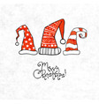 christmas card with three red hats vector image vector image