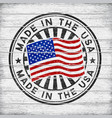 made in the usa stamp on wooden background vector image vector image