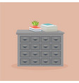 metal filing cabinet with potted plant vector image