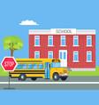 bus standing in front of brick school vector image vector image