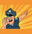 a friendly police man pointing in the direction vector image