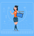 girl holding clapperboard modern video blogger vector image vector image