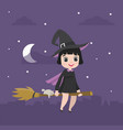 Cute kid halloween character in witch costume on
