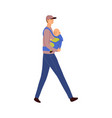 father carries baby in an ergo vector image
