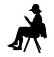 woman silhouette sitting on a chair with mobile vector image