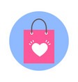 shopping bag with heart shape icon on blue round vector image vector image