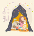 mum and her kids playing in a tepee tent vector image
