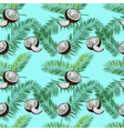 Coconut palm leaves seamless pattern on blue vector image vector image