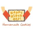 Happy birthday cookies on a pan in hands vector image vector image