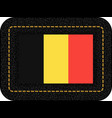 flag of belgium icon on black leather backdrop vector image