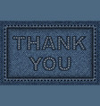 thank sign on blue denim vector image vector image