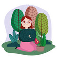 young woman in grass with potted plants trees vector image