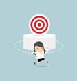 businesswoman running around the target vector image vector image