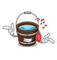 listening music wooden bucket mascot cartoon vector image vector image