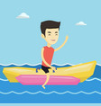 tourists riding a banana boat vector image vector image