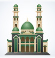 Islamic mosque building with green dome and two to