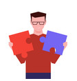 man holds two pieces puzzle and unites them vector image vector image