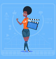 african american girl holding clapperboard modern vector image vector image