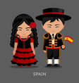 spaniards in national dress with a flag vector image vector image