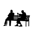 two elderly people silhouettes sitting on a bench