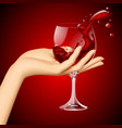 womans hand with red wine in the glass on dark vector image