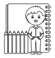cute little student boy with pencils colors and vector image