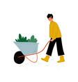 girl pushing wheelbarrow with seedlings young vector image vector image