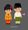 malaysians in national dress with a flag vector image vector image