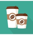 Two coffee to go paper cups icon vector image