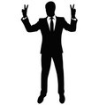 silhouette of a man showing a gesture of victory vector image vector image