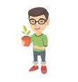 caucasian smiling boy holding a potted plant vector image vector image