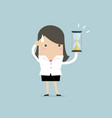 businesswoman holding sandglass or hourglass vector image vector image