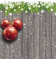 Christmas baubles on a wooden background vector image vector image