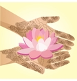 Hands decorated with henna indian woman holding a vector image vector image