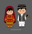 afghans in national dress with a flag vector image vector image