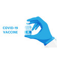 hand in gloves holds vaccine vector image vector image