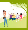 tourist makes photo friends together under tree vector image vector image
