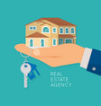 hand holding house and key real estate agency vector image