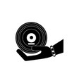 hand holding vinyl melody sound music silhouette vector image
