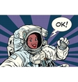 OK gesture woman astronaut in a spacesuit vector image vector image