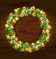 green christmas wreath decorated with gold balls vector image