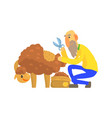 old bearded farmer sheaving wool from sheep vector image vector image