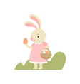 lovely bunny in pink dress with basket full of vector image vector image