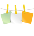 Color blank paper pieces on rope vector image
