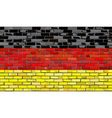 Grunge flag of Germany on a brick wall vector image